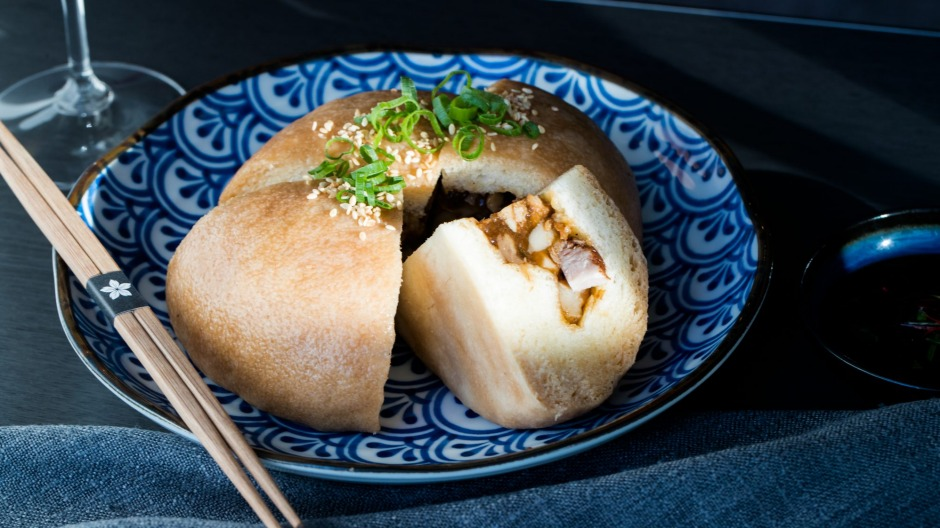 The giant pork bun, stuffed with a chunky mix of belly pork, chestnuts and mustard greens.