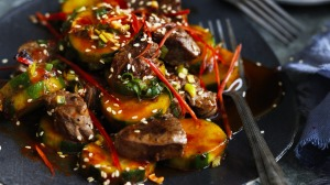 Add some chopped kimchi and rice to make a meal of this fiery beef and cucumber combination.