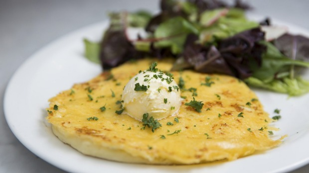Cheese and potato pancake topped with whipped butter.