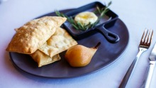 Holy Goat La Luna cheese, rosemary and cumin bread crisps and hay-baked pear at Paringa Estate.