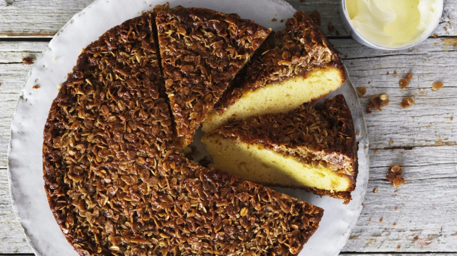Butter cake with a golden Anzac biscuit topping.