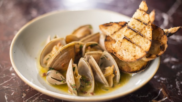 Cloudy Bay clams with smoky bacon and grilled sourdough.