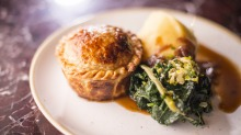 Beef and Guinness pie with buttered cabbage and silverbeet and mashed potato ticks all the pie boxes.