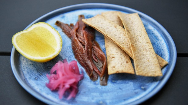 Ortiz anchovies with house-pickled onions, a lemon cheek and crostini.