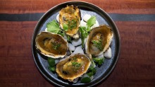Oysters grilled in the shell and dressed with a rich yuzu miso cream.