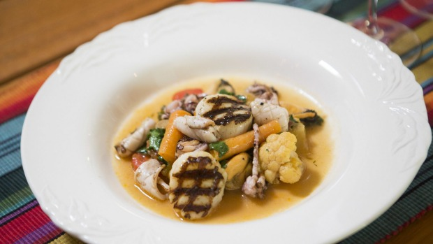 Go-to dish: Scallops, grilled calamari, and mussels with vegetables a la grecque.