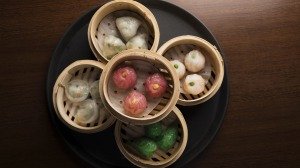 Steamed vegan dumplings of many colours.