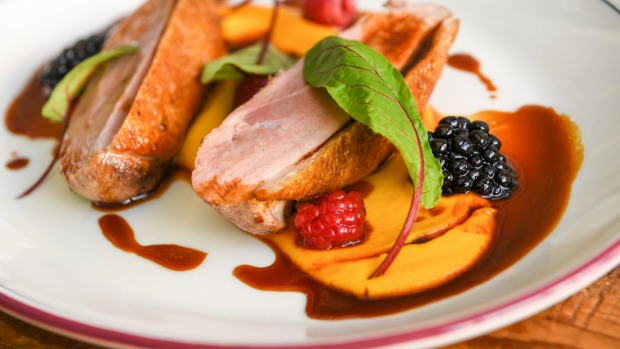 Hay-smoked duck breast with carrot puree and berries.