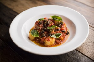 Potato gnocchi with tomato sugo and deep-fried capers.