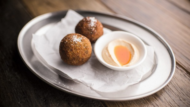 Arancini, deep-fried risotto balls loaded with parsley and lemon zest.