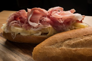 A Rocco Roll with ruffles of prosciutto.
