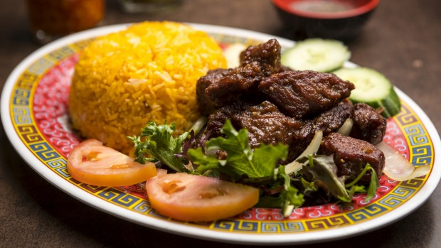Tender beef cubes with red rice.