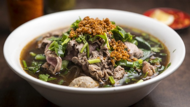 Thai noodle soup with sliced beef.