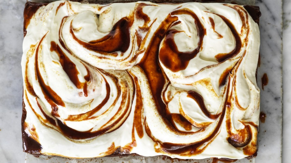 A slab of banana cake with cream cheese icing and swirls of optional  miso caramel.