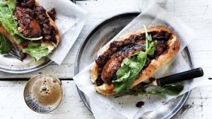 The secret is to cook the snag in sauce: Adam Liaw's perfect barbecued sausage in a bun.