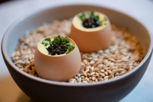 Snacks might include a soft-boiled egg with cream corn and caviar.