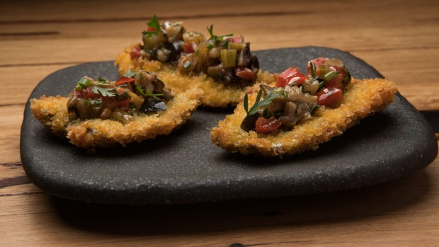 Crumbed butterflied sardines with eggplant caponata.