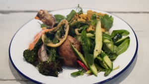 Go-to dish: Wood roasted chicken with broccolini and romesco.