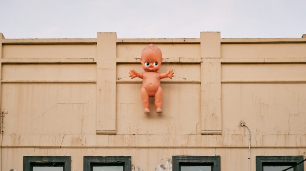 The kewpie doll retains its position on the Bimbo facade.