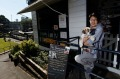 Naoko Okamoto with Douglas out front of Cafe Chew Chew Pet Restaurant, part of a growing trend of eateries catering for ...