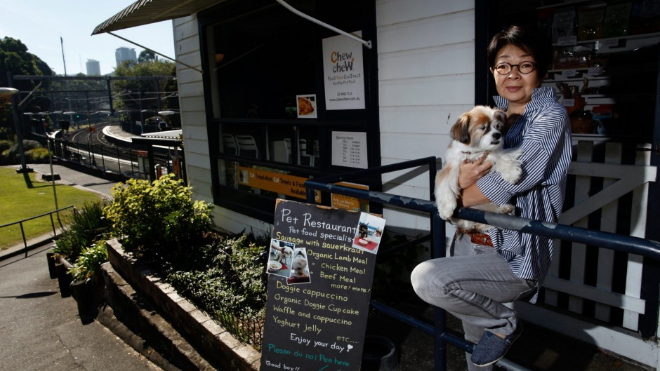 Naoko Okamoto with Douglas out front of Cafe Chew Chew Pet Restaurant, part of a growing trend of eateries catering for dogs.