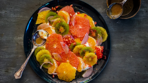 Kefir, citrus and fruit salad with cumin, honey, ginger and lemon dressing recipe. Flu fighters recipes for Good Food May 2019. Please credit Katrina Meynink. Good Food use only.
