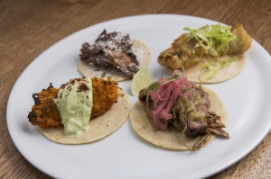 Taco flight with pumpkin, lamb shoulder, fried barramundi and beef tri-tip fillings.
