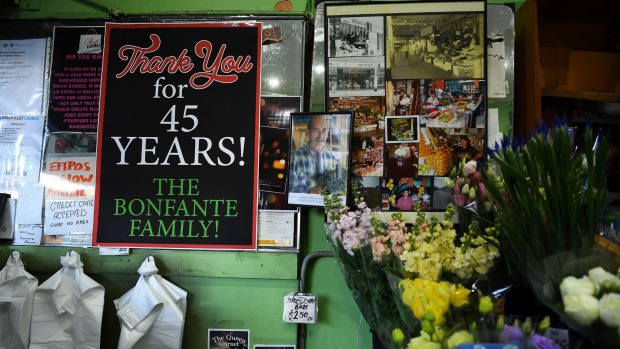 A thank you sign is surrounded by photos on the wall of Frank's.
