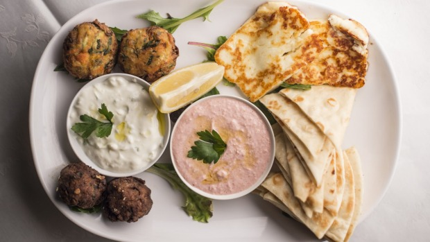 The mezze plate for two includes garlicky tzatziki and salmon-pink taramasalata.