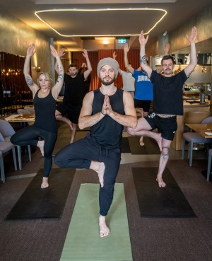 The staff at Amaru do a weekly yoga class with Paolo Arlotta (centre), a chef and yoga teacher.