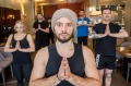 The staff at Amaru doing a weekly yoga class with Paolo Arlotta in the restaurant dining room.
