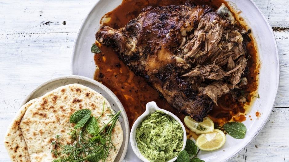 Whole roast lamb shoulder with Sichuan sauce, coriander and mint paste and sesame flatbread.