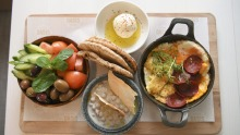 The big Lebanese breakfast with scrambled eggs, sausage, halloumi and more.