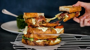 Caprese toasted sandwich with homemade pesto and onion jam.