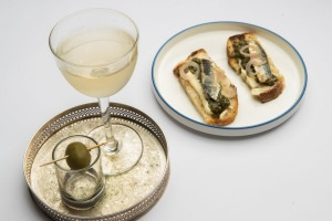 Sardines on toast and smoked olive martinis are available from brunch to dinner.
