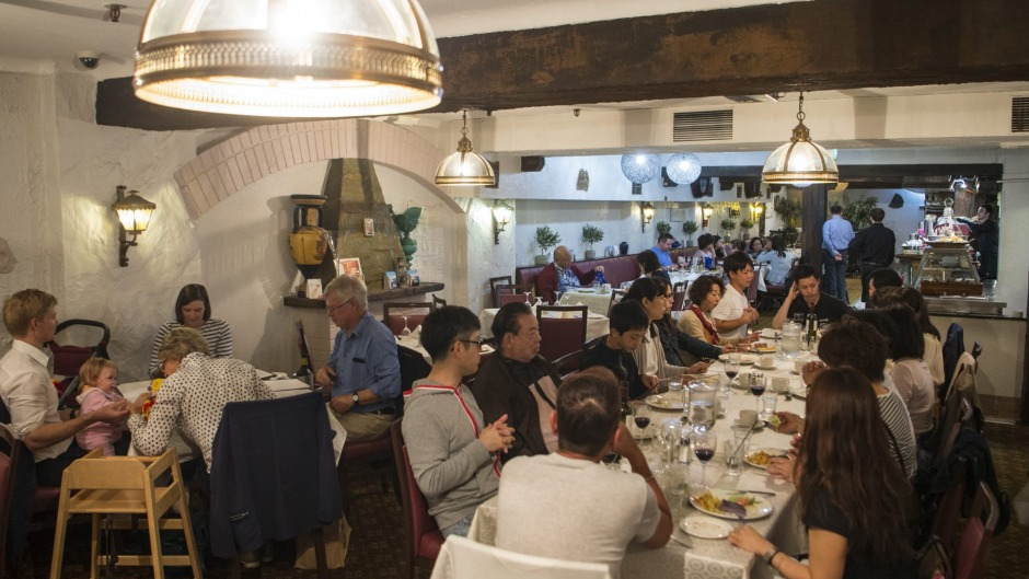 Diethnes Greek Restaurant  is a place for family dinners and long lunches.