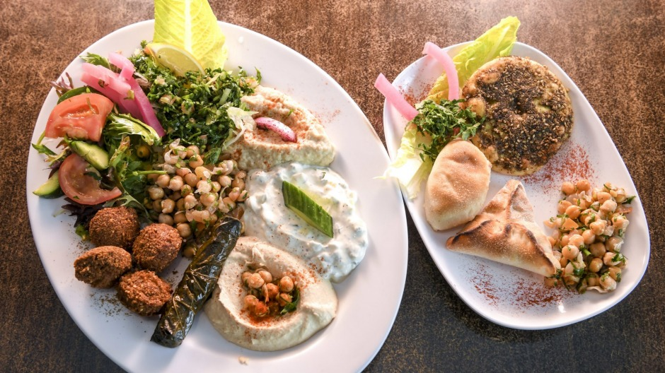 Vegos don't get off lightly: the vegetarian platter with cheese and spinach breads, zaatar 'pizza', chickpea salads, ...