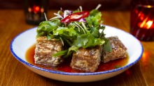 Red Spice Road's signature pork belly dish is coming to its new home.