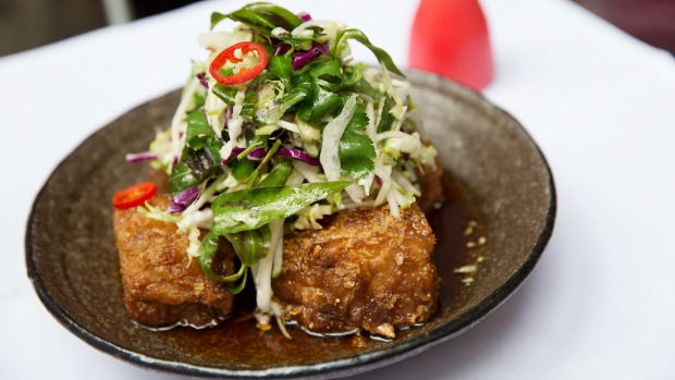 Red Spice Road's signature pork belly with chilli caramel, black vinegar and apple slaw.