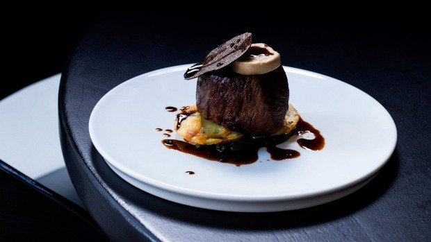 Angus beef Rossini with foie gras parfait and truffle glaze.