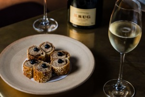 Krug champagne paired with suckling pig sausage rolls atBennelong in Sydney.
