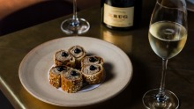 Krug champagne paired with suckling pig sausage rolls at Bennelong in Sydney.