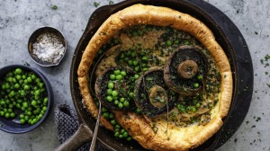 Giant Yorkshire pudding with roasted mushrooms and creamy mushroom sauce.