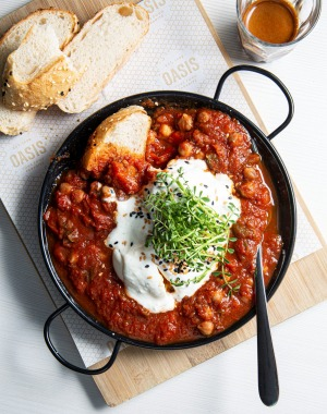 Shakshuka - eggs baked in chickpea and onion-mined tomato sauce.