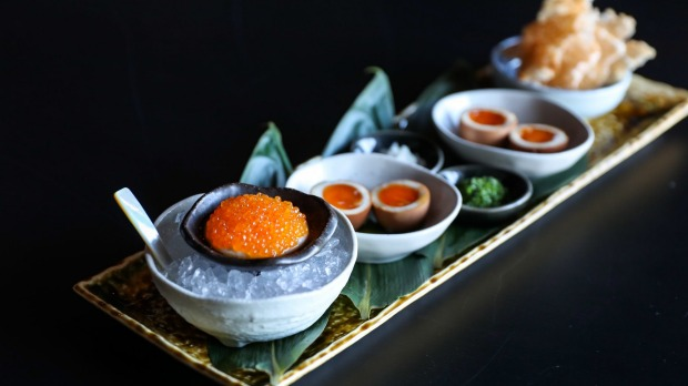 Chuuka's roe service with house-marinated trout roe, cashew cream, shallots, chives, tea eggs and potato rice crackers.