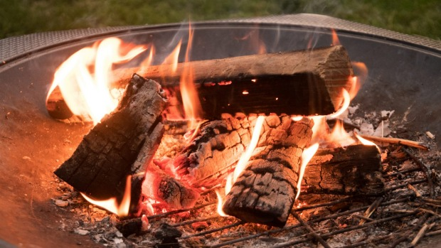 Relaxing Wood fire in the backyard fire pit Portable firepits can be priced from $300 upwards, while permanent ones are much more dear.