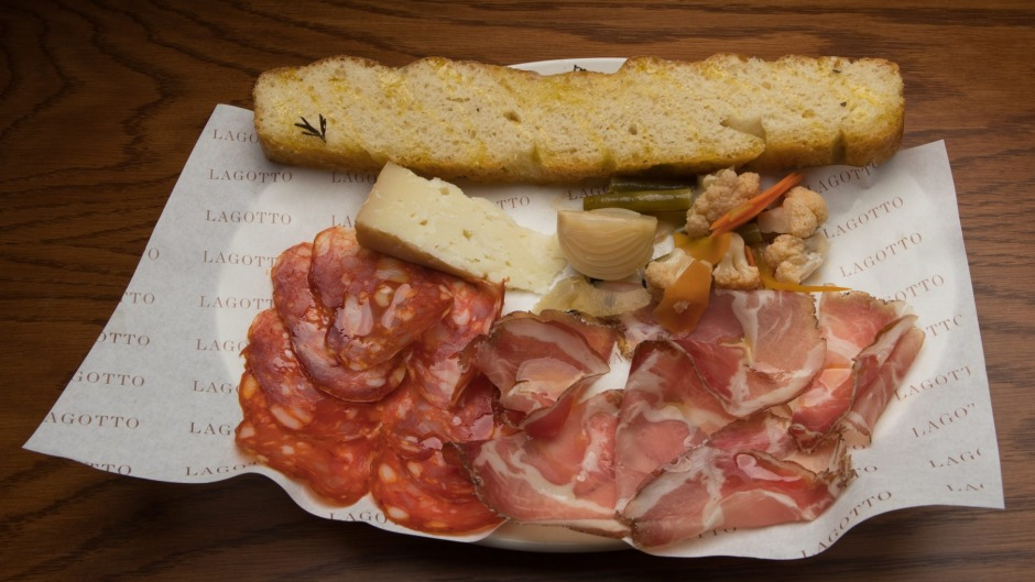 A snacky selection of salumi and cheese with giardiniera pickles.