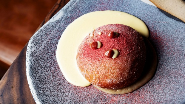 6 Head's doughnut is a sugared puffball with creme anglaise, fig sauce and strawberry powder.