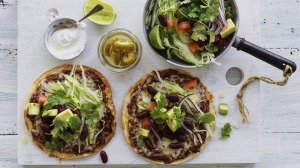 Tortillas with cheesy, speedy smashed beans.