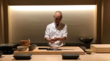 Hiroyuki Sato at his Hakkoku restaurant in Tokyo. With only six seats and a six-month waiting list, the sushi shrine is ...